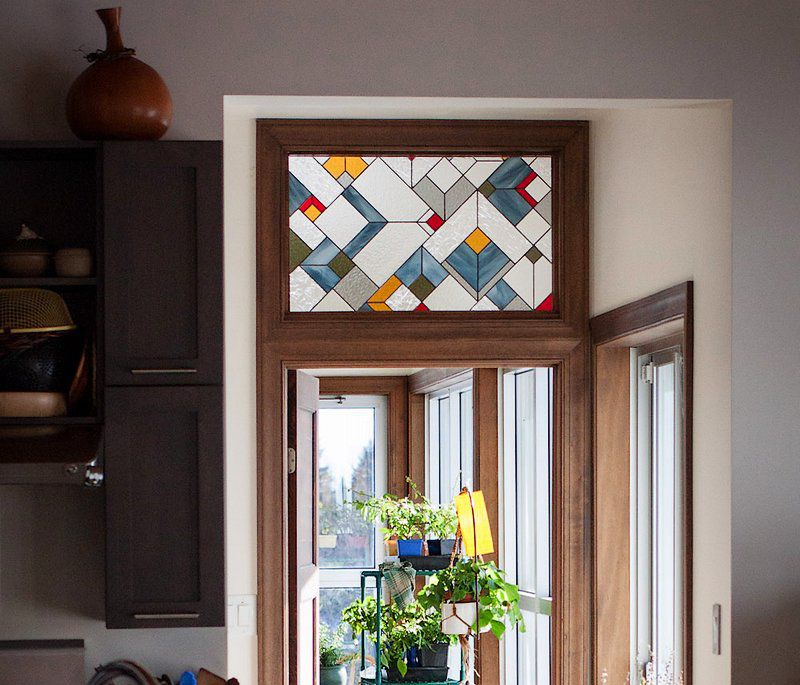 Geometric pattern stained glass transom