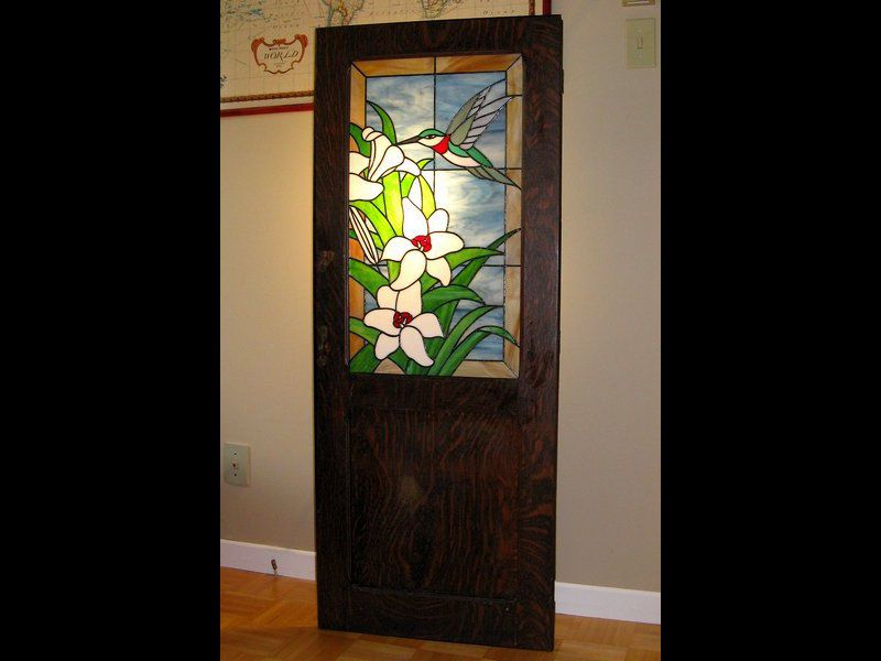 Stained glass panel on an antique closet